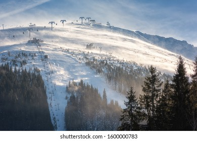 Chopok mount in Low Tatras, popular ski resort in Slovakia (Slovensko). Beautiful winter landscape with snowy mountains and blue sky