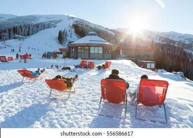 CHOPOK, SLOVAKIA - JANUARY 12, 2017: Skiers and snowboarders taking a rest in chairs near apres ski bar near Chopok, January 12, 2016 in Jasna - Slovakia