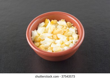 Chopped boiled eggs in a cup