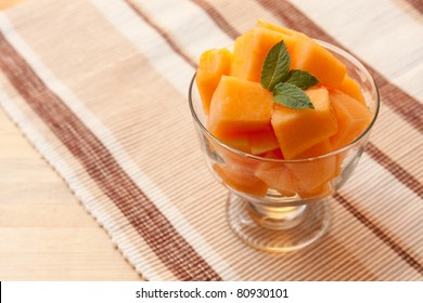Chopped Cantaloupe in a Glass Bowl with Mint
