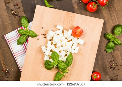 Chopped colorful ingredients on a cutting board