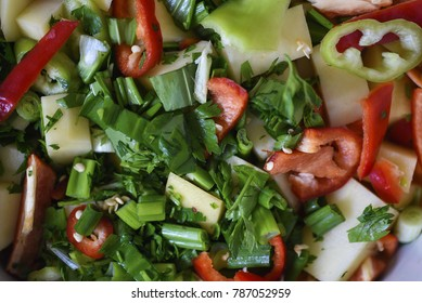 Chopped colorful vegetables in a frying pan
