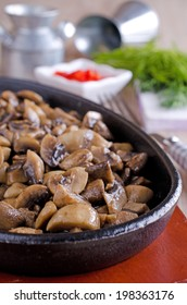 chopped and cooked mushrooms, lying in a frying pan