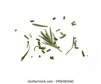 chopped fresh rosemary sprinkled on a white background. Aromatic spice rosemary isolated on white.
