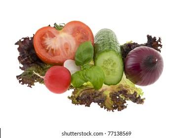 Chopped fresh vegetables on white background