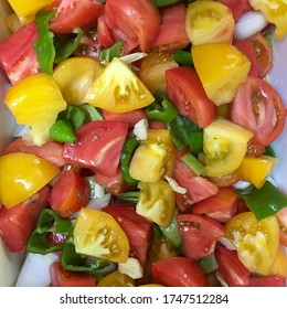 Chopped fresh yellow and red tomato for a salad.