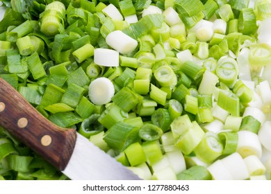 Chopped Green Onions. Fresh Spring Onions with Kitchen Knife. Healthy Scallion.