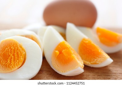 chopped hard boiled eggs on wooden plate