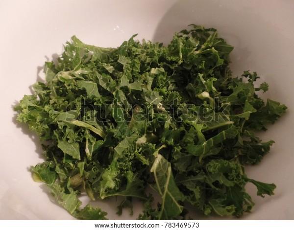 Chopped kale in a white bowl
