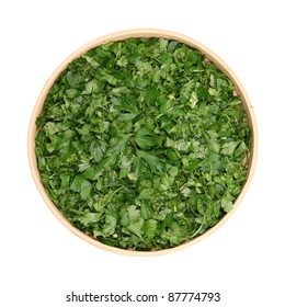 chopped leaves of fresh herbs, parsley, dill, cilantro, basil, in dereyannoy bowl isolated white background