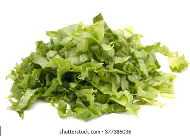 chopped lettuce leaves on a white background
