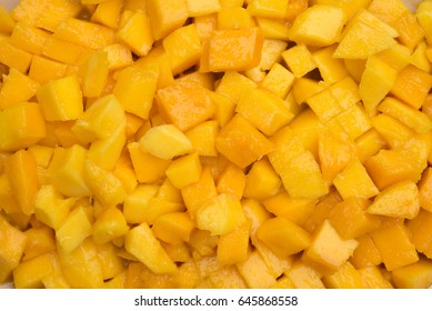 Chopped mango. Orange juicy fruit background. Top - down view, a close-up.