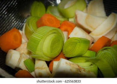 Chopped mirepoix in a sieve