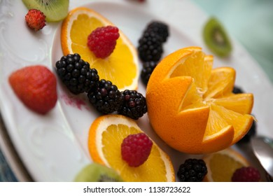 Chopped orange and berries in the foreground