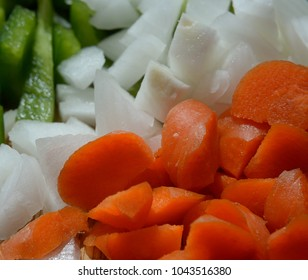 Chopped organic carrots, white onion and green pepper