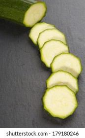 Chopped organic courgette on a dark background