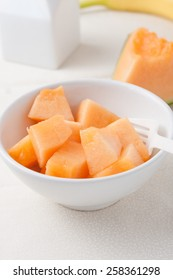chopped pieces of cantaloupe melon in a bowl
