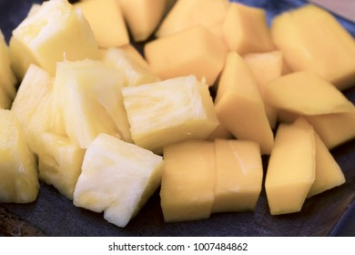Chopped pineapple and mango close-up.