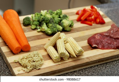 chopped and prepared stir fry ingredients including steak and vegetables