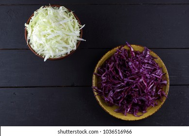 Chopped purple and green cabbage on a wooden background, cabbage on the plate, sliced cabbage in a minimalist style, rustic vegetables, a vegetarian product, vitamins, healthy food, art