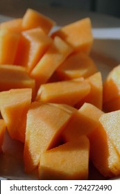 Chopped raw cantaloupe melon, prepared for eating