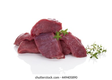 Chopped raw fresh beef pieces isolated on white background. Culinary meat eating.