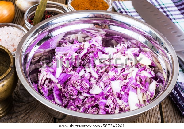 Chopped red cabbage in a metal bowl. Studio Photo