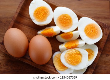 chopped and sliced hard boiled eggs on wooden plate