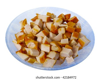 chopped smoked chicken meat in the blue plate ready for the appetizer or fondue isolated on white