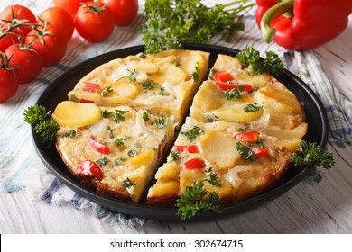 Chopped Spanish omelette with potatoes and vegetables close-up. horizontal