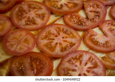 chopped tomatoes on dough