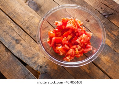 Chopped Tomatoes On Wooden Table In Glass Bowl. Selective Focus With Copy Space. Top View.