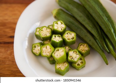 Chopped and whole of Okra and on white plate