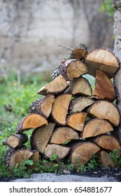 Chopped wood arranged in the garden,copy space.