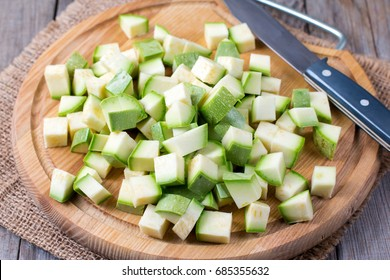 Chopped zucchini on wooden board.jpg