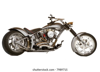 Chopper motorcycle with lots of chrome.