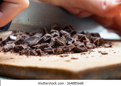 Chopping chocolate with a knife (in detail)