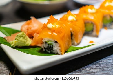 Chopstick roll  salmon sashimi and shoyu soy sauce in japanese restaurant
