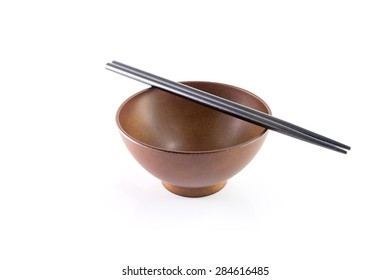 Chopsticks in asian set table isolated on white