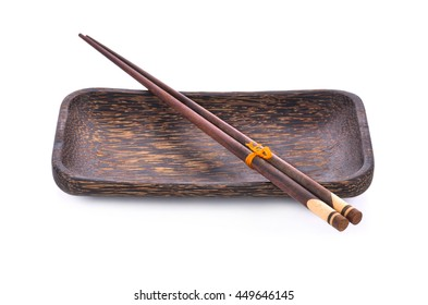 chopsticks and dish made of palm wood