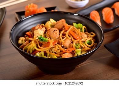 Chopsticks holding chinese noddles - Yakisoba