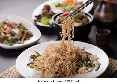 chopsticks holding Chinese noodles