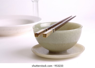chopsticks, jade bowl and a plate