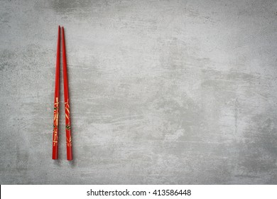 Chopsticks on gray concrete stone table background
