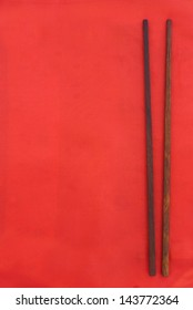 chopsticks on red background