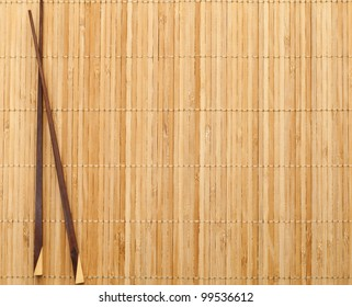 chopsticks on straw mat