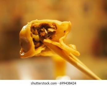 Chopsticks showing inside a Beijing dumpling