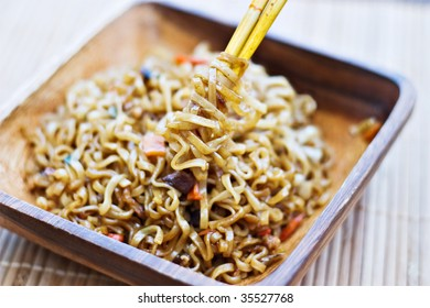 Chopsticks wrapped with oriental noodles