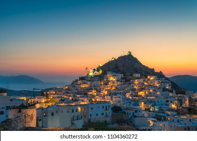 Chora village in Ios island in Greece at sunset.