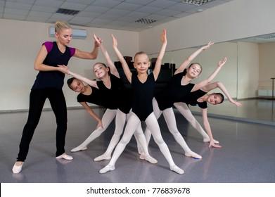 The choreographer teaches children dances.